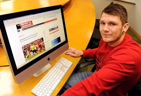 James Norwood checks out his signing story on the SNJ website this afternoon, Monday