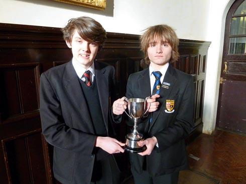 Marling School students Sean Kemsley and Tom Carlile with their trophy after winning the Taylor Trophy Junior Debating Competition