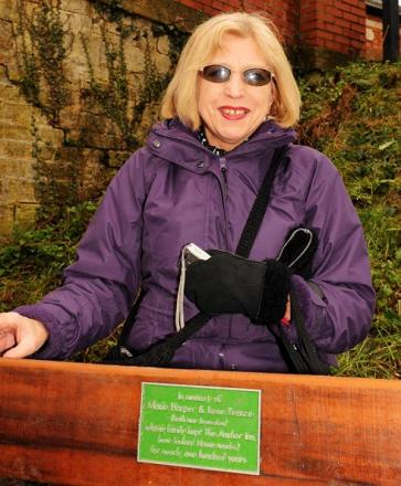 Pat Harper by the new bench at Ryeford Wharf