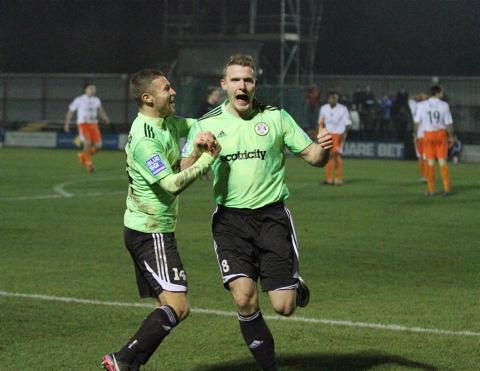 Yan Klukowski (right) celebrates his goal with Matty Taylor. Picture: Shane Healey