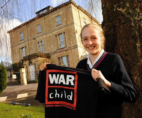 Chloe Bayliss, 13, pictured outside Wycliffe Preparatory School. Chloe raised more than £700 for War Child by cycling nearly 20 miles to school on her 13th birthday