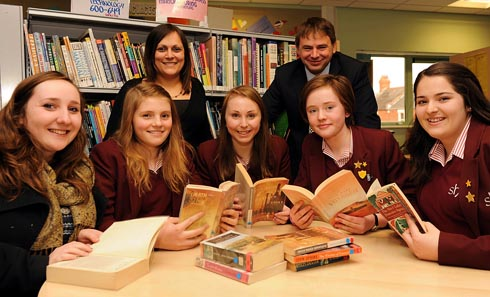 Matt Hannam, head of English at Stroud High School, and Ria Patel, deputy head of English, with students (l-r) Amy Watson, 17, Alice Madeley, 15, Megan Neale, 15, Grace Arber, 13, and Olivia Nicholson, 14, in the school library.