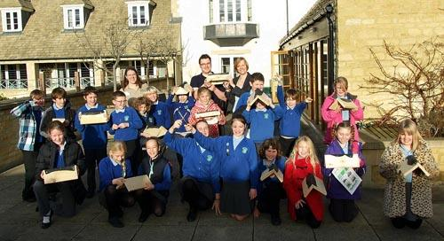 Children from The Croft Primary School with the wooden toad homes they made at Richmond Retirement Village in Painswick