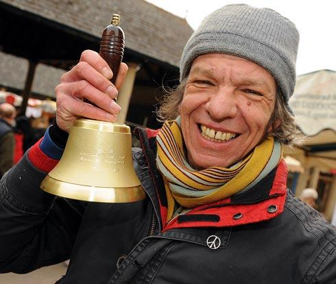Kardien (Gerb) Gerbrands with the 2012 bell awarded to Stroud FarmersÕ Market which is a national winner in the 2013 Local Food Awards and is a Certified Farmers' Market of the year