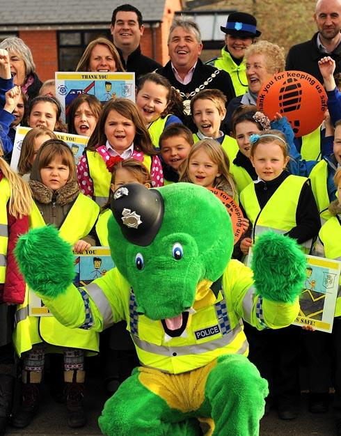 Colin the Crocodile Copper promoting the Thank You For Keeping Us Safe campaign at Park Junior and Park Infant schools in Stonehouse