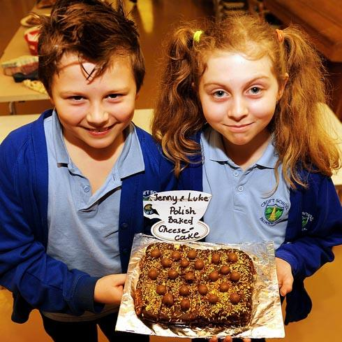 Luke Hitchcock, eight, with his sister Jenny, 10 and their Polish cheesecake at The Croft Primary School's bake off on Friday