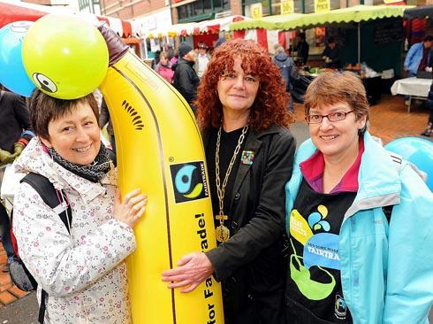 Fairtrade supporters Ceri Sheppard (left) and Ginny Young are given a send off from Stroud farmersÕ market by mayor Amanda Moriarty (centre) on Saturday