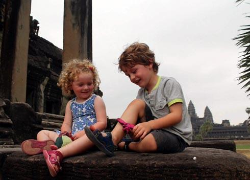 Siblings Layla, two, and Finley, four, play together near the temples at Angkor Wat in Cambodia