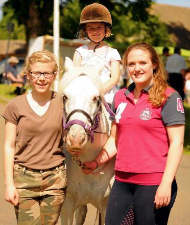 Frankie Salmon, five, enjoying a pony ride at Last year's Oakridge revels with Adele Alderwick, 12, (left) and Alyssia Boardman