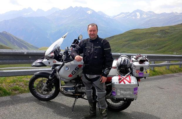 Fundraiser Tim Jamfrey at the Grossglockner Pass in Austria during his 3,000 mile motorcycle challenge which raised £3,500 for the Cotswold Care Hospice