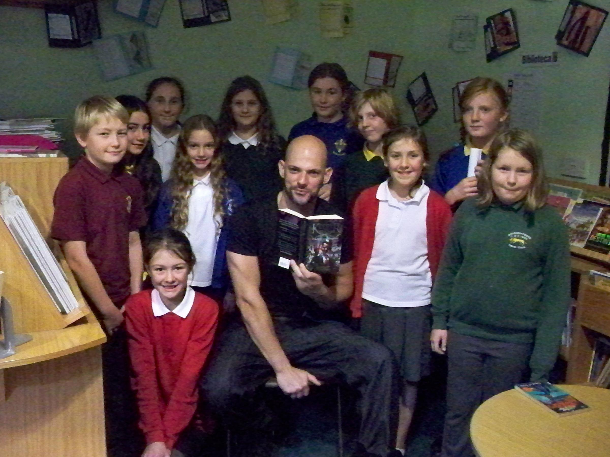Fantasy author Marcus Alexander with pupils from 10 school's across the district during a workshop to inspire young writers at Gastrells Primary School (1678905)