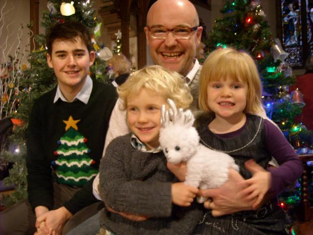 BBC Radio Gloucestershire traffic presenter Jack Miles and presenter Chris Baxter with his children William, five and Dorothy, three at the turning on of the Christmas Tree Festival at St Laurence Church on Sunday         (2805697)
