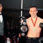 Stroud News and Journal: Richard Buskin after winning the lightweight UFW champion belt