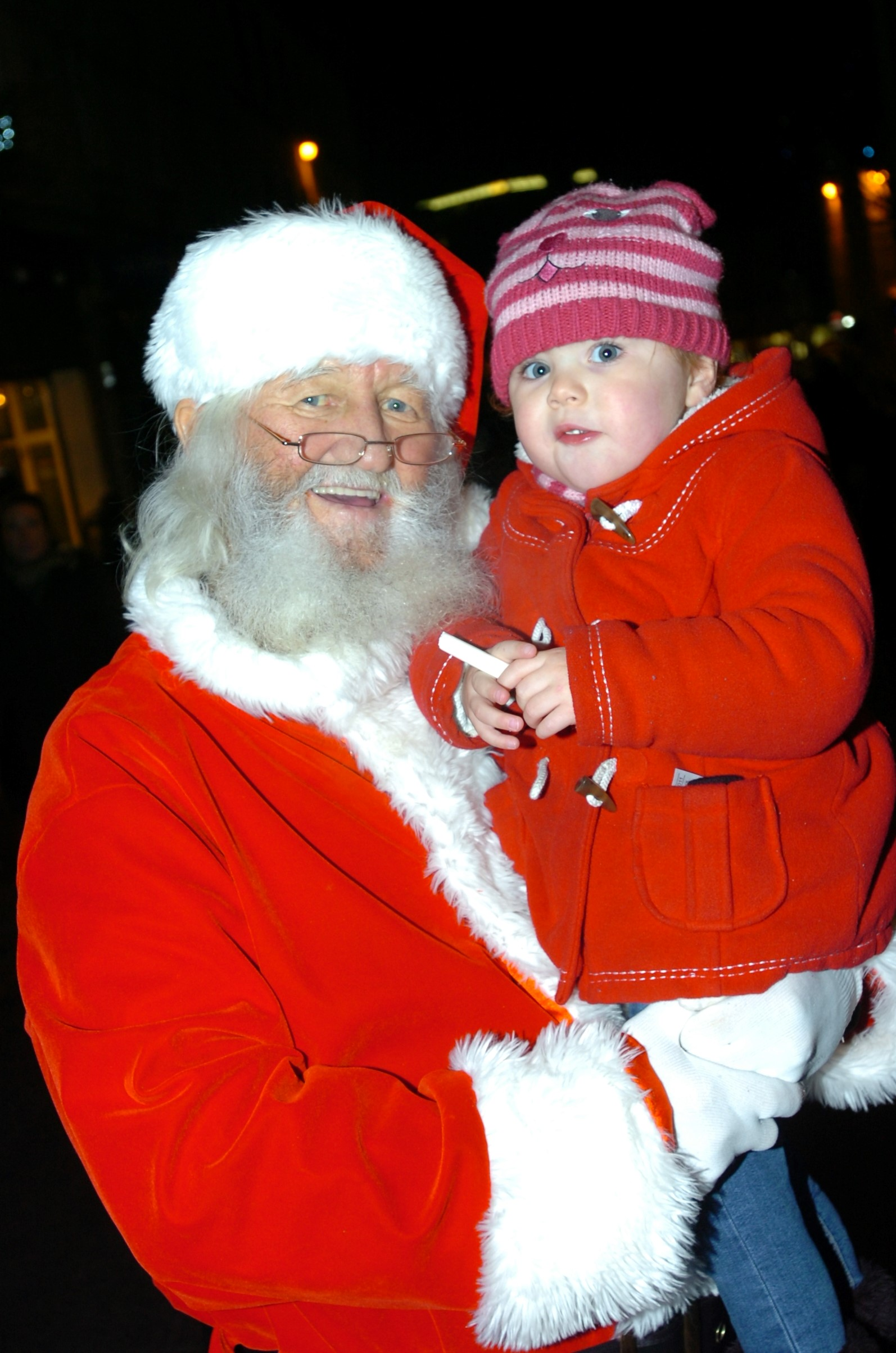 Kaitlyn Marshall, two, who meets Santa, who was actually her great grandfather