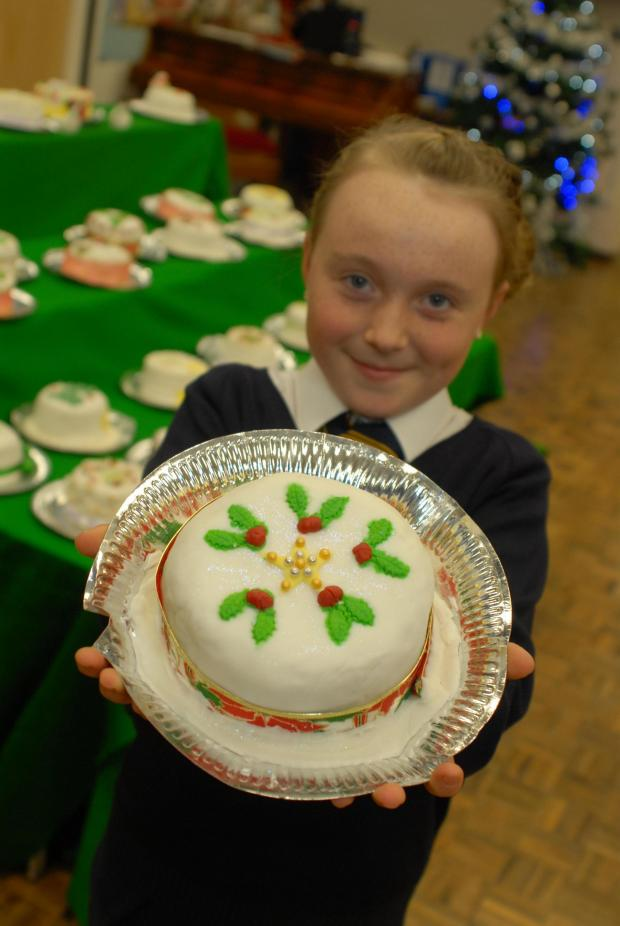 Stroud News and Journal: Rosary School Year six pupil Alisha Underwood with her Great Christmas Bake Off Christmas Cake (3017389)