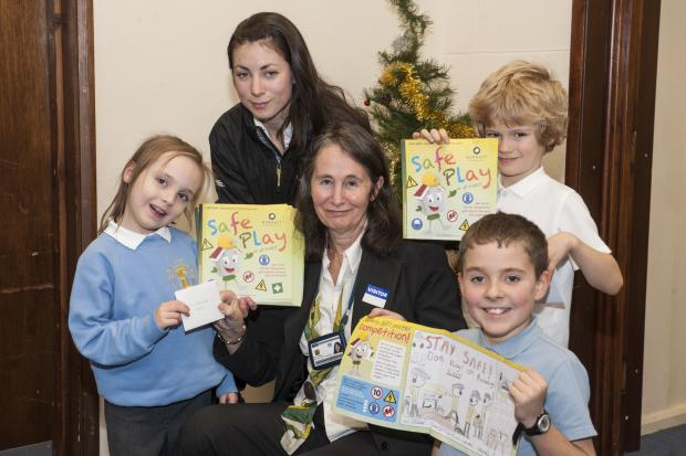 Staff from Barratt Homes Dove Hill development present prizes to the poster winners from Leonard Stanley Primary School. (l-r) Erin Simmonds, Year 1, assistant site manager Bethan Powell,  sa