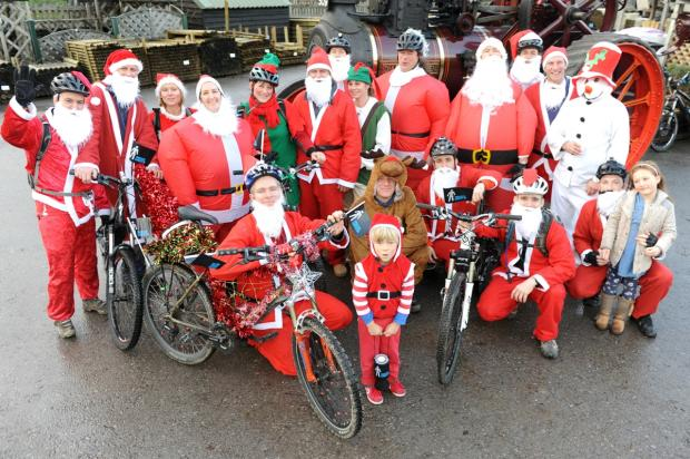 HO! HO! HO! - A group of cycling Santas abandoned their sleighs and took to their bikes for a charity ride from Stroud to Nailsworth on Saturday to raise money for a good Claus