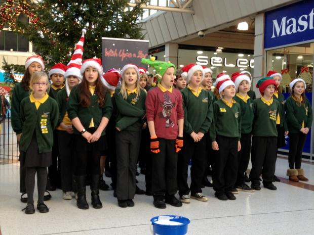 Children from Gastrells Community Primary School sang carols at the Merrywalks Centre to raise money for Winston's Wish