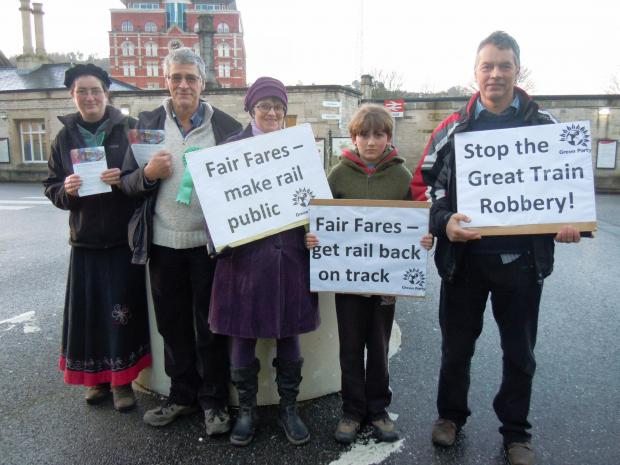 Stroud News and Journal: Members of Stroud Green Party protest against annual hikes in the cost of rail travel outside the town's train station on Thursday, January 2   (3270379)
