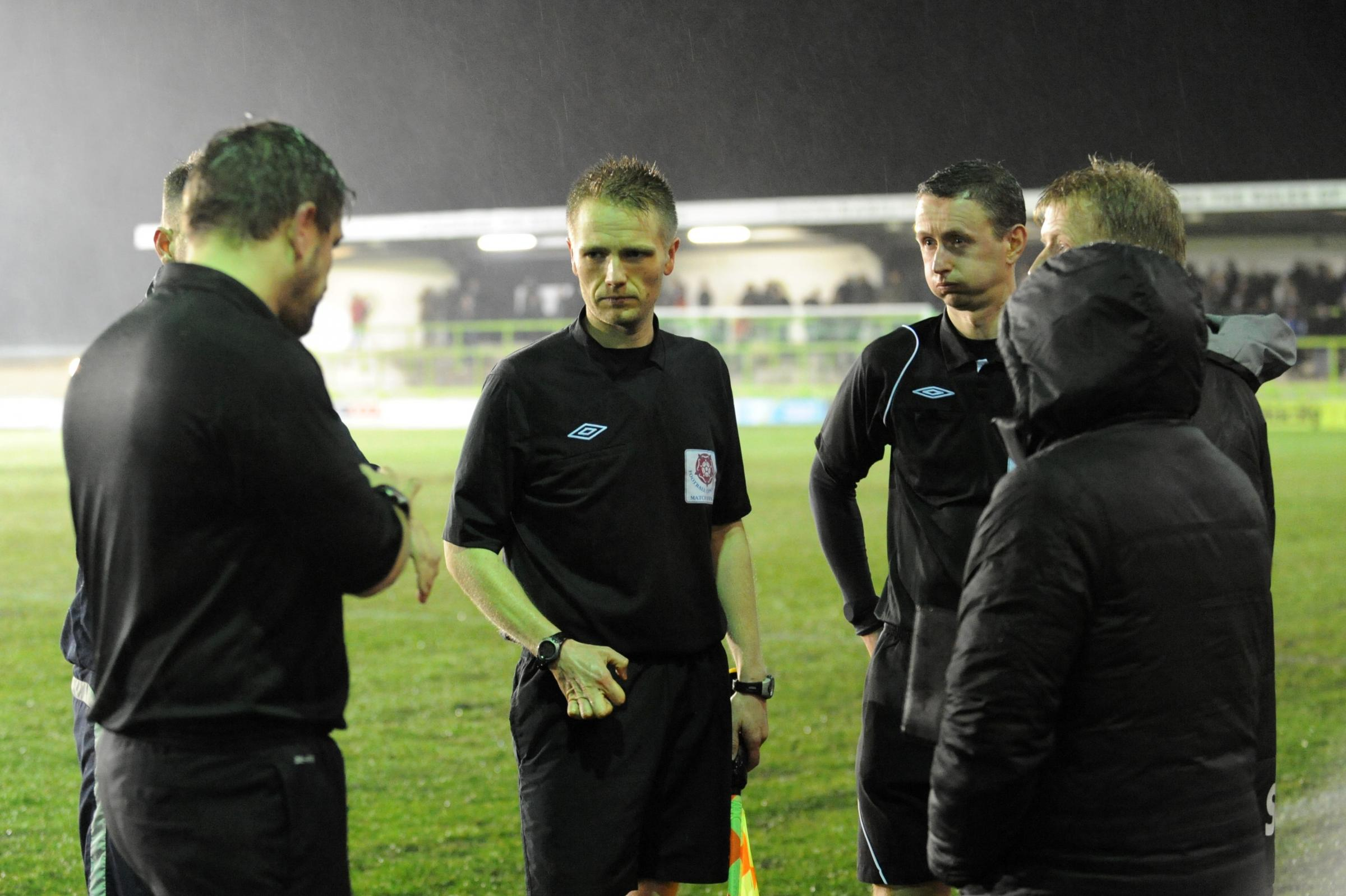 Match officials at the New Lawn discuss the floodlight failure  Pic: Tom Wren