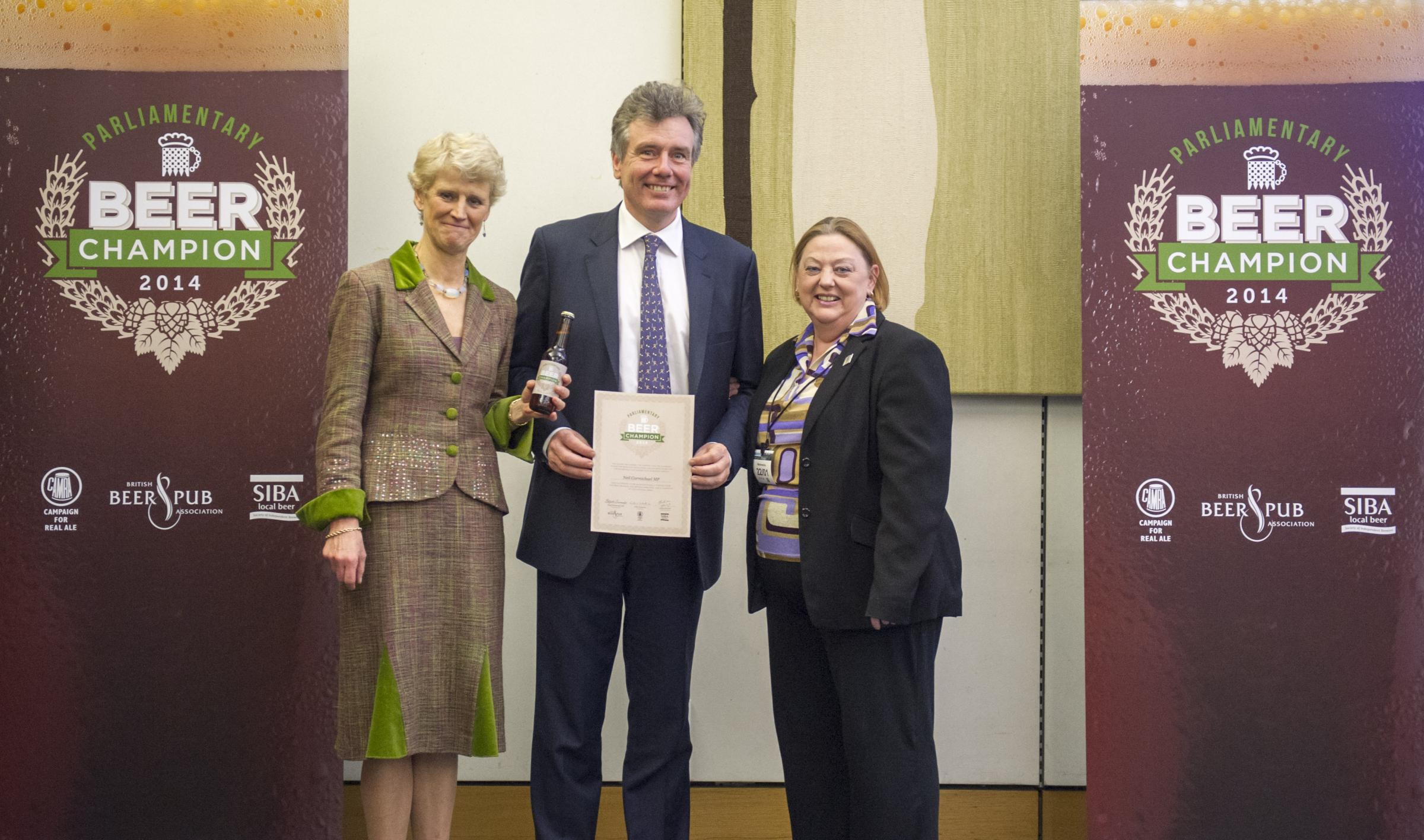 Neil Carmichael MP receives his 'Beer Champion' award from the BBPA's Brigid Simmonds OBE  and Jackie Parker, of CAMRA (3669583)