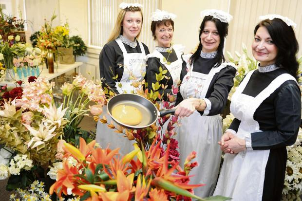 Stroud News and Journal: The Thomas family (l-r) Ami, Cally, Kim and Eva from Faux Flower Design are dressing as French maids to try and collect food for Stroud District Foodbank (3791676)