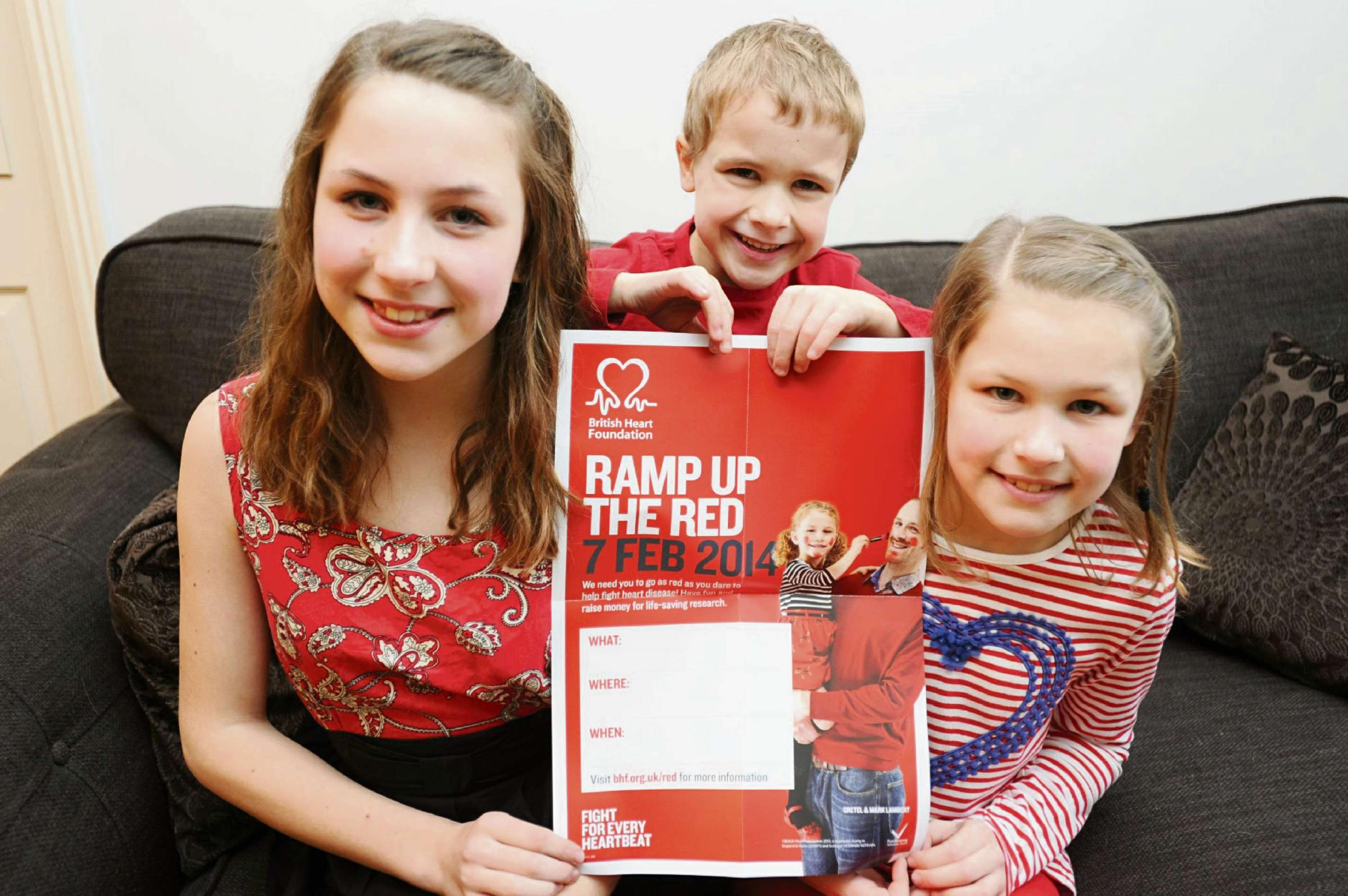 Charlie Robbins, 5, with sisters Lauren, 13, and Beth, 10. Charlie's school is holding a 'dress in red' day for the BHF