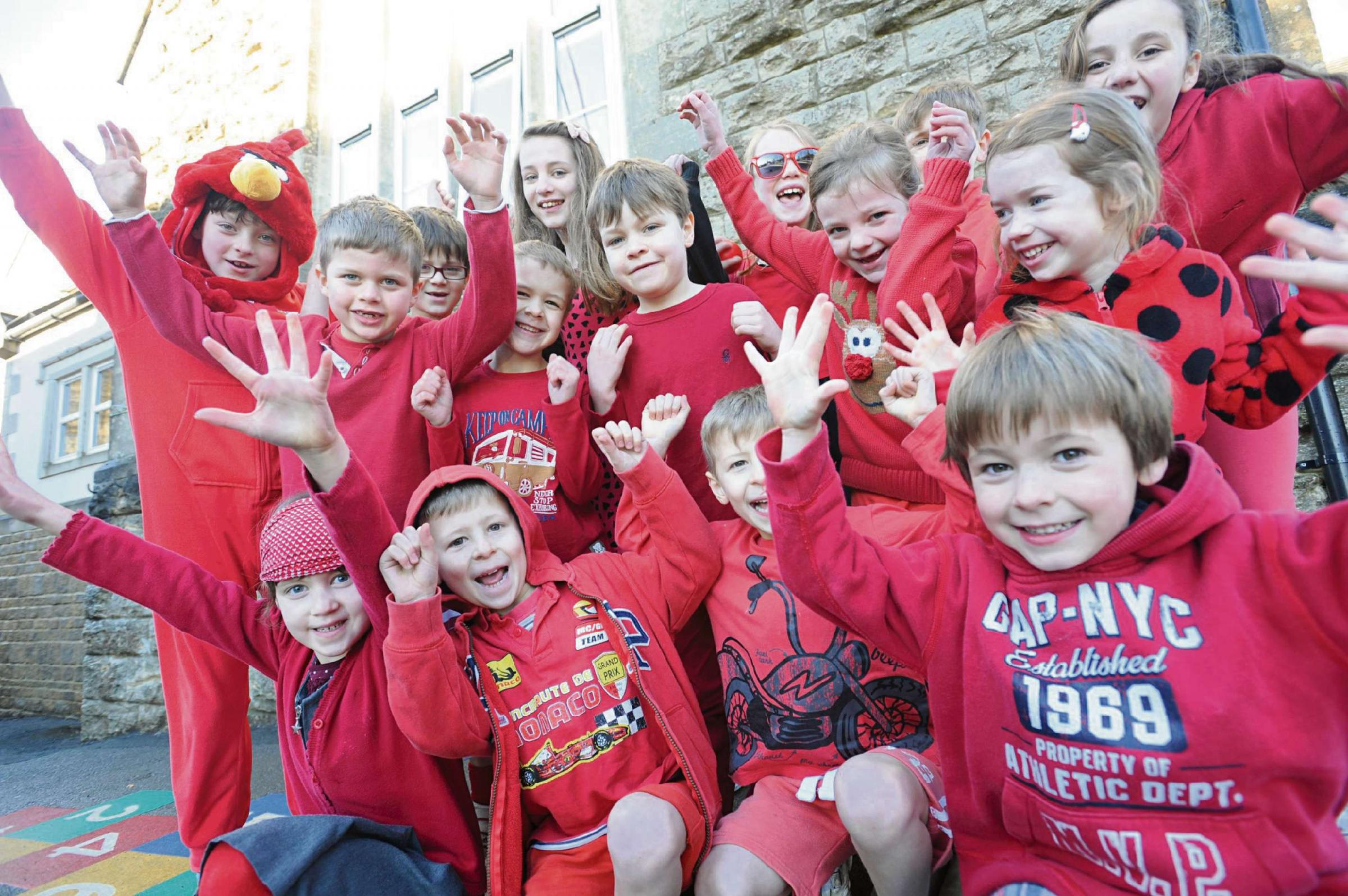 Pupils and care home residents wear red for heart disease