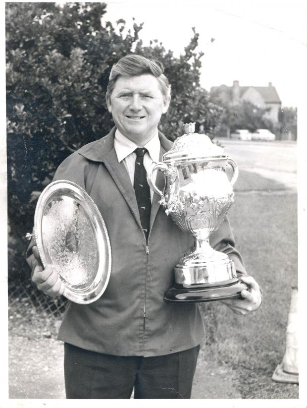 Stroud News and Journal: Gordon Jones, pictured here with the Neave Parker Trophy for the British Air Pistol Championships, has died at the age of 82