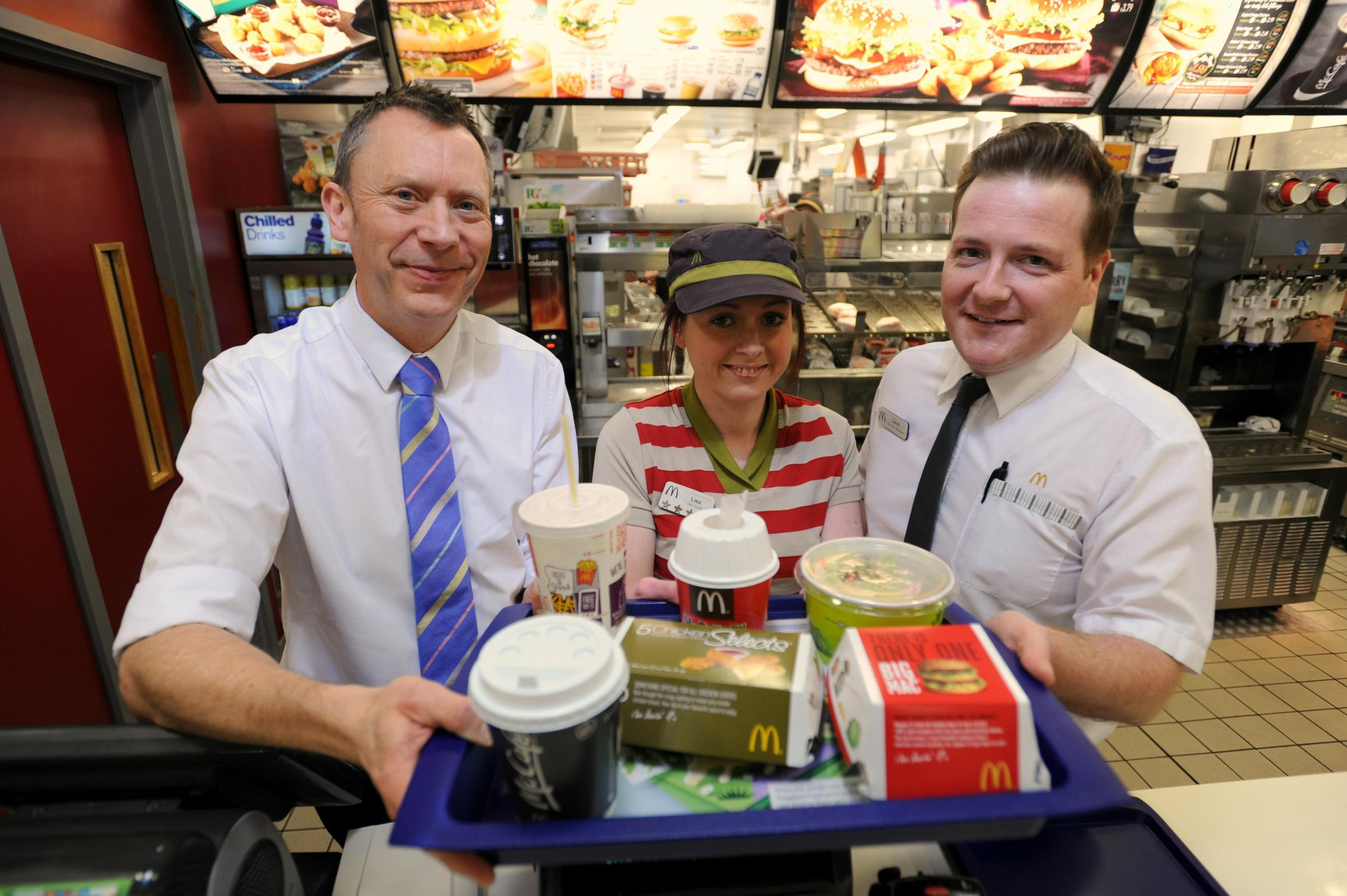 (l-r) McDonald's francisee Paul Booth, crew trainer Lisa Carter and business manager for the Stroud branch Dave Roebuck