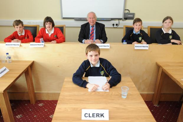 (back l-r) Tom Organ, 10 and Eva Underdown, 11, from Eastington Primary, cheif magistrate Davi