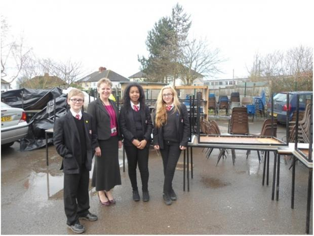 Maidenhill School headteacher Pam Wilson and students from Year 9 with the furniture they have donated to the charity Education for All