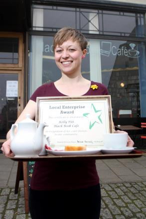 Kelly Pitt manager of Black Book Cafe in Nelson Street, Stroud,with the local enterprise certificate which was awarded to her by Stroud Town Council in recognition of her contribution to the community