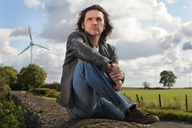 Dale Vince, Founder of Ecotricity, pictured by the company's first wind turbine at Nympsfield, Gloucestershire