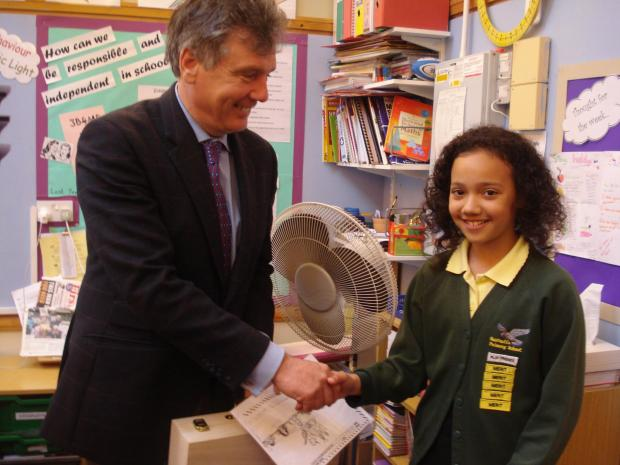 ART AWARD: Neil Carmichael MP presents the Court Artist prize to Mea Edmond at Gastrells Community Primary School.