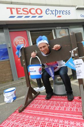 In stock, Kevin Hall, manager of the Tesco Express in Stratford Road, Stroud, takes part in the fundraising day in aid of the supermarket chain's affiliated charity Diabetes UK