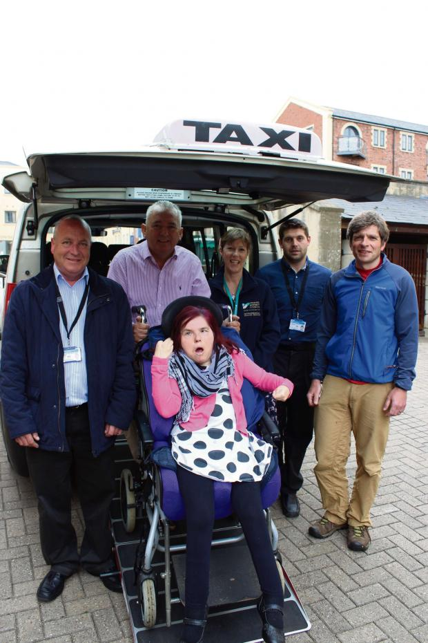 Stroud News and Journal: Front: Disabled taxi-user Rachel Jessop with (back left) Colin Bayley from Apollo Taxis, Nick Hodder from Lifeways, Rachel Andrew from Stroud District Council