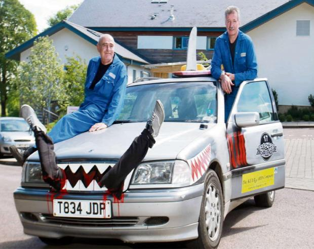 Dave Shaylor and Gary Browning with Jaws, the car they will drive across Europe in aid of Cotswold Care Hospice