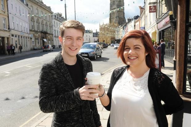Stroud News and Journal: Luke Cameron hands over a gift cup of coffee to Clarissa Loveridge as part of his Good Deed Diary