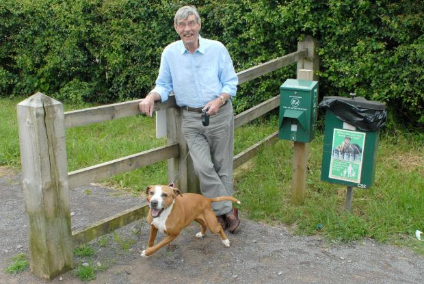David Shipp by one of the dog bins on The Ridings in Chipping Sodbury