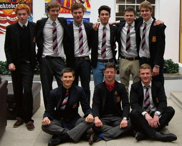 Wycliffe College sixth formers squeezed into their old school uniforms to raise money to buy specialist equipment for former student Rob Camm who was left paralysed from the neck down after a car accident