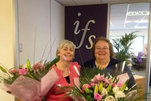 Champagne and flowers for long-serving Stonehouse financial workers