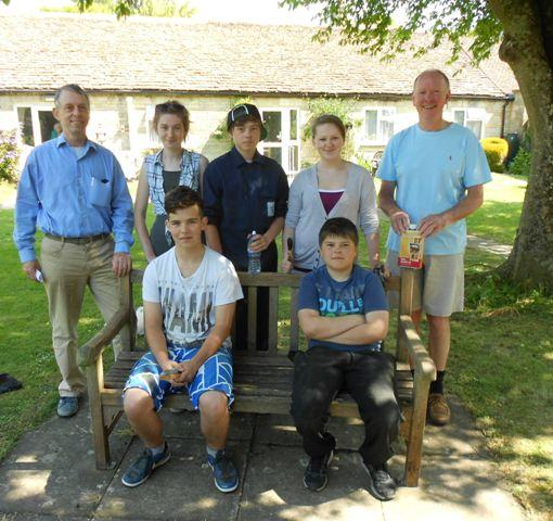 Minchinhampton Youth Club show off the bench they helped save