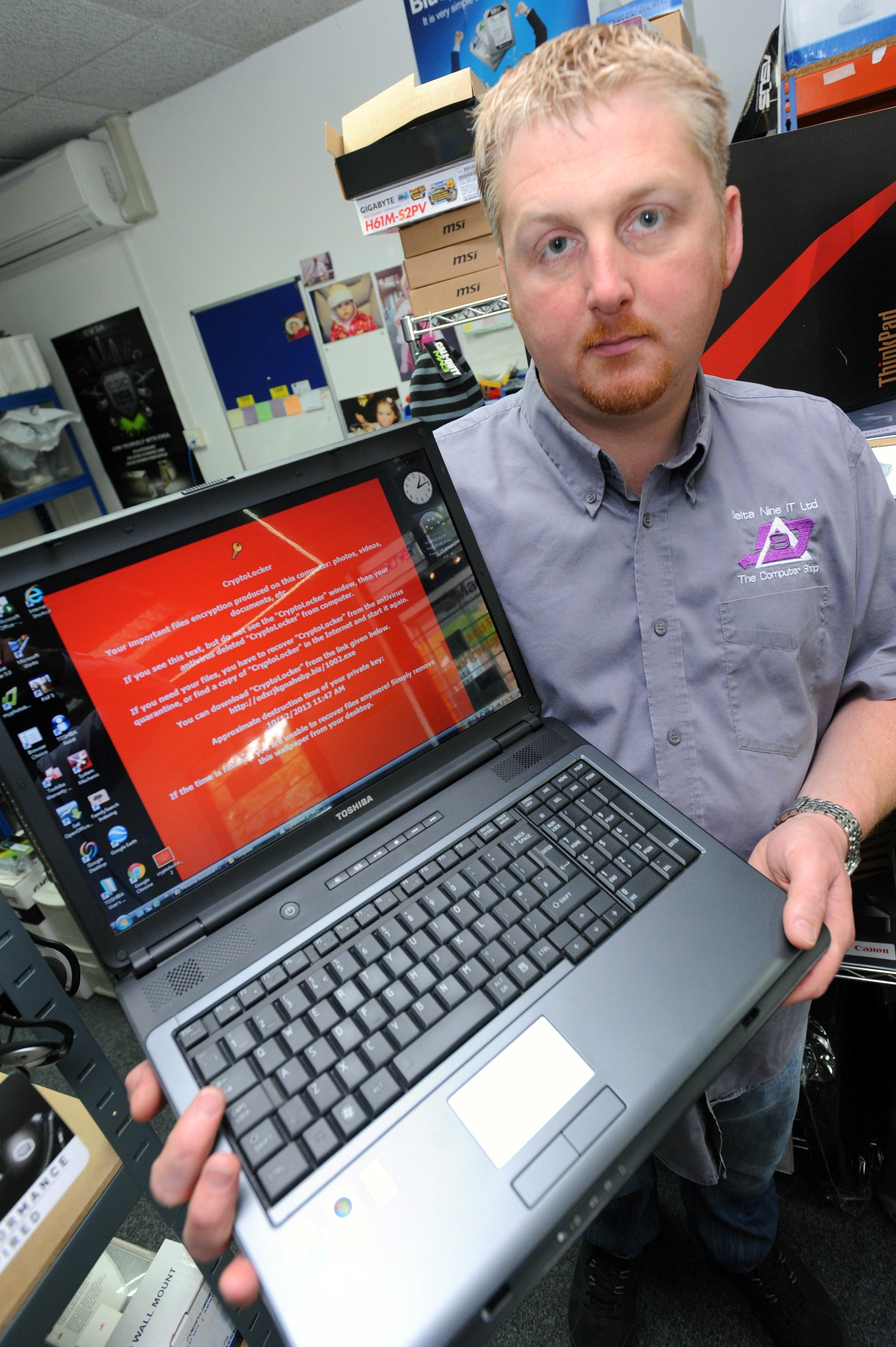 Director of Delta Nine IT Limited, Jamie Dickinson, with a computer that has been infected with the Cryptolocker virus