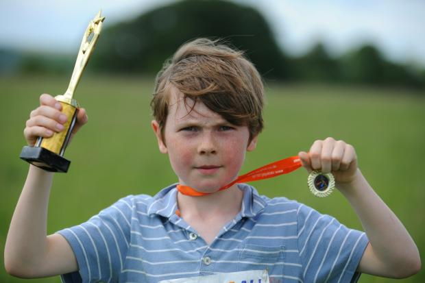 Archie Dowie won first place in 1K race for children aged five to 10 in Race 4 All held on Minchinhampton Common