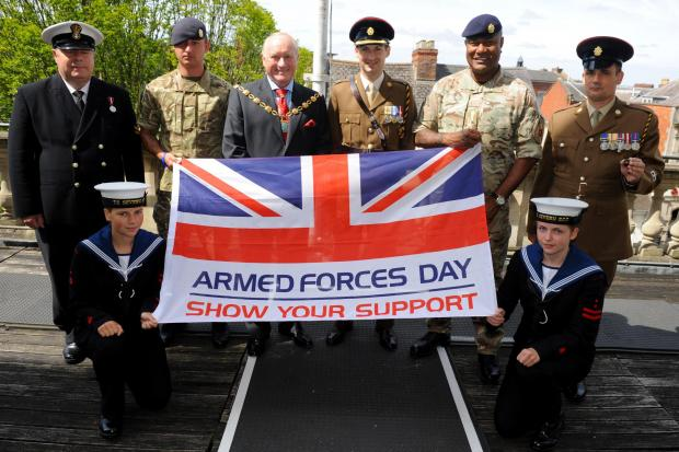 (back l-r) Paul White, Andrew Davies, Stroud Distrcit Council chairman Mark Rees, Richard Cudsworth, Jonetani Tuiauta, Neil Butcher, Leah Jones (front left), 17 and Flossy Campion with the Armed Forces Day flag (7578719)