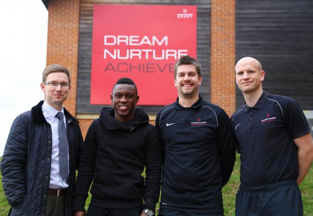 L-R Tom Radcliffe (Director of Football), Waris, Paul Tassell (junior football manager), Marc Richards (senior football manager).
