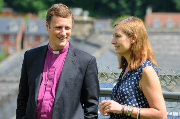 Martyn Snow, The Bishop of Tewkesbury, chats to Karen Riordan during a visit to Brimscombe Primary School