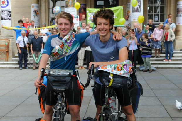 Stroud News and Journal: (l-r) Best friends Jonas Pollard and Matthias Christian, both 19, cycled 4,000 miles across 14 European countries to raise money for Macmillan Cancer Support.