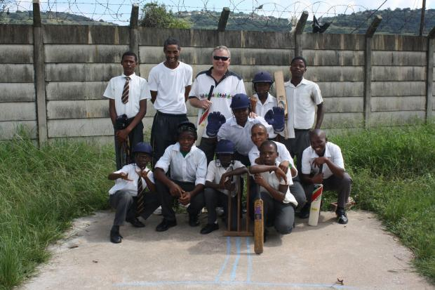 LEGEND: Former Gloucestershire and South Africa all-rounder Mike Procter with children from Ottawa Primary school who have been supported by The Mike Procter Foundation